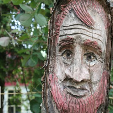 Wooden sculpture of a re-bearded man