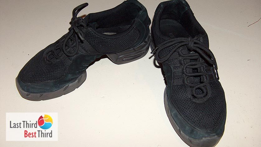 Pair of used black dance shoes.