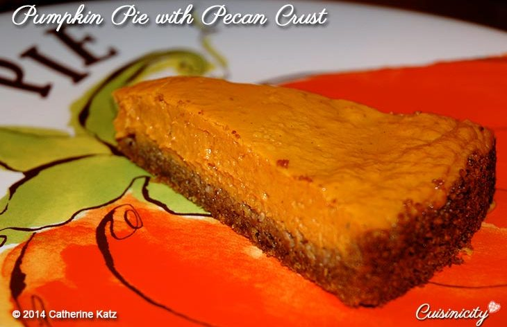 Cuisinicity Pumpkin Pie with Pecan Crust on a decorative pumpkin plate